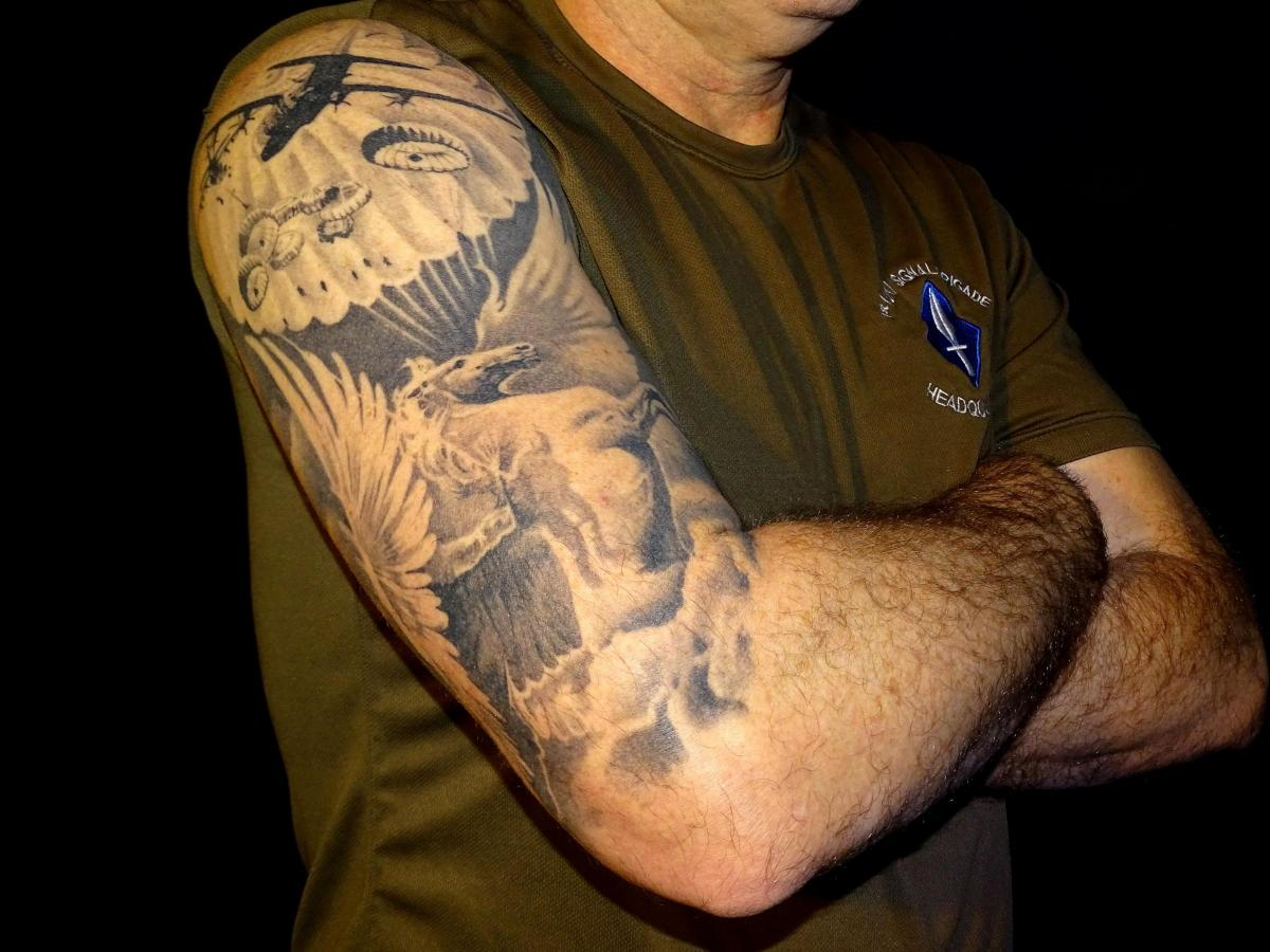 Museum exhibition of military personnel's tattoos showcases