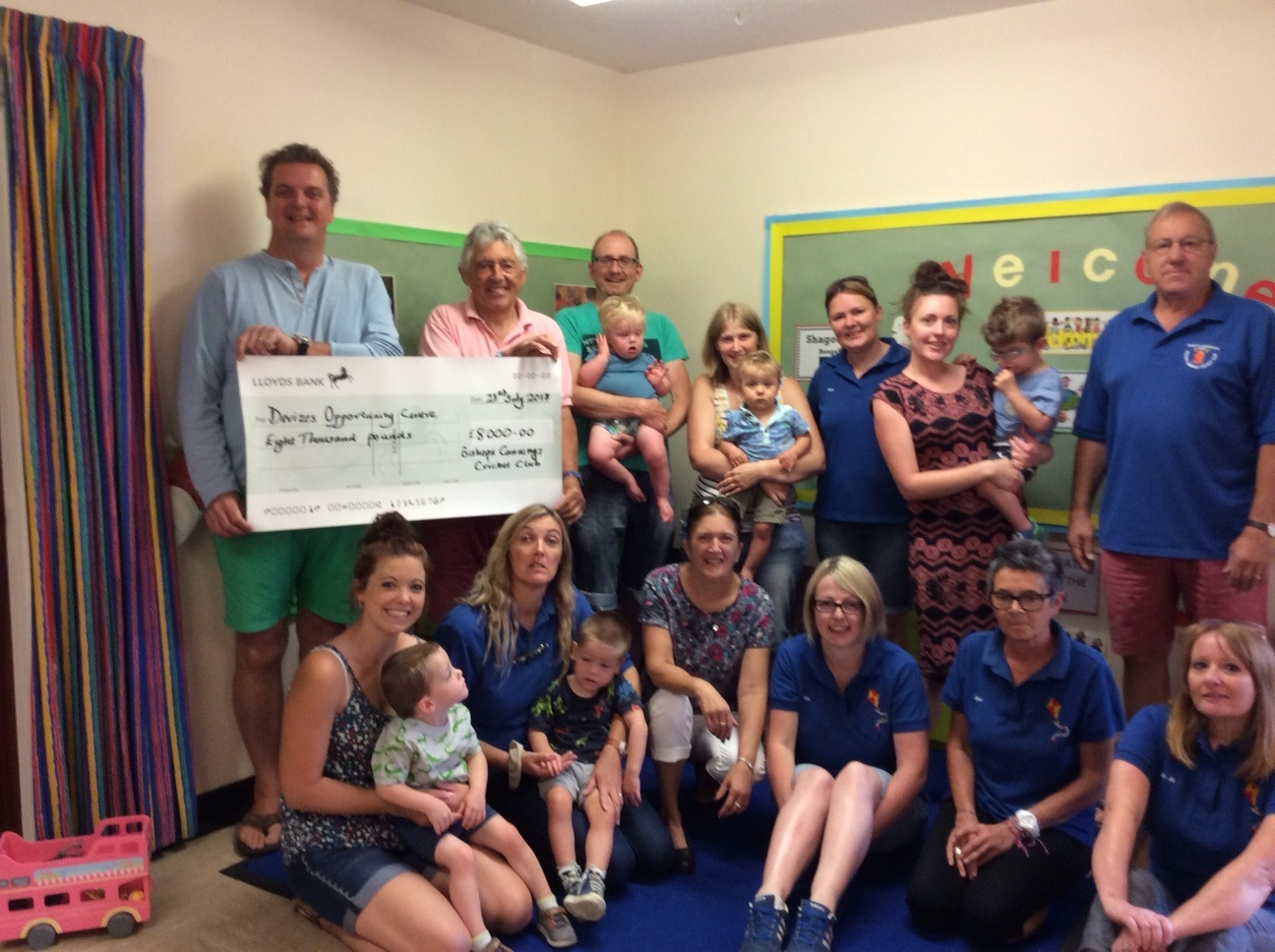 Cricket club members present cheque to Devizes Opportunity Centre