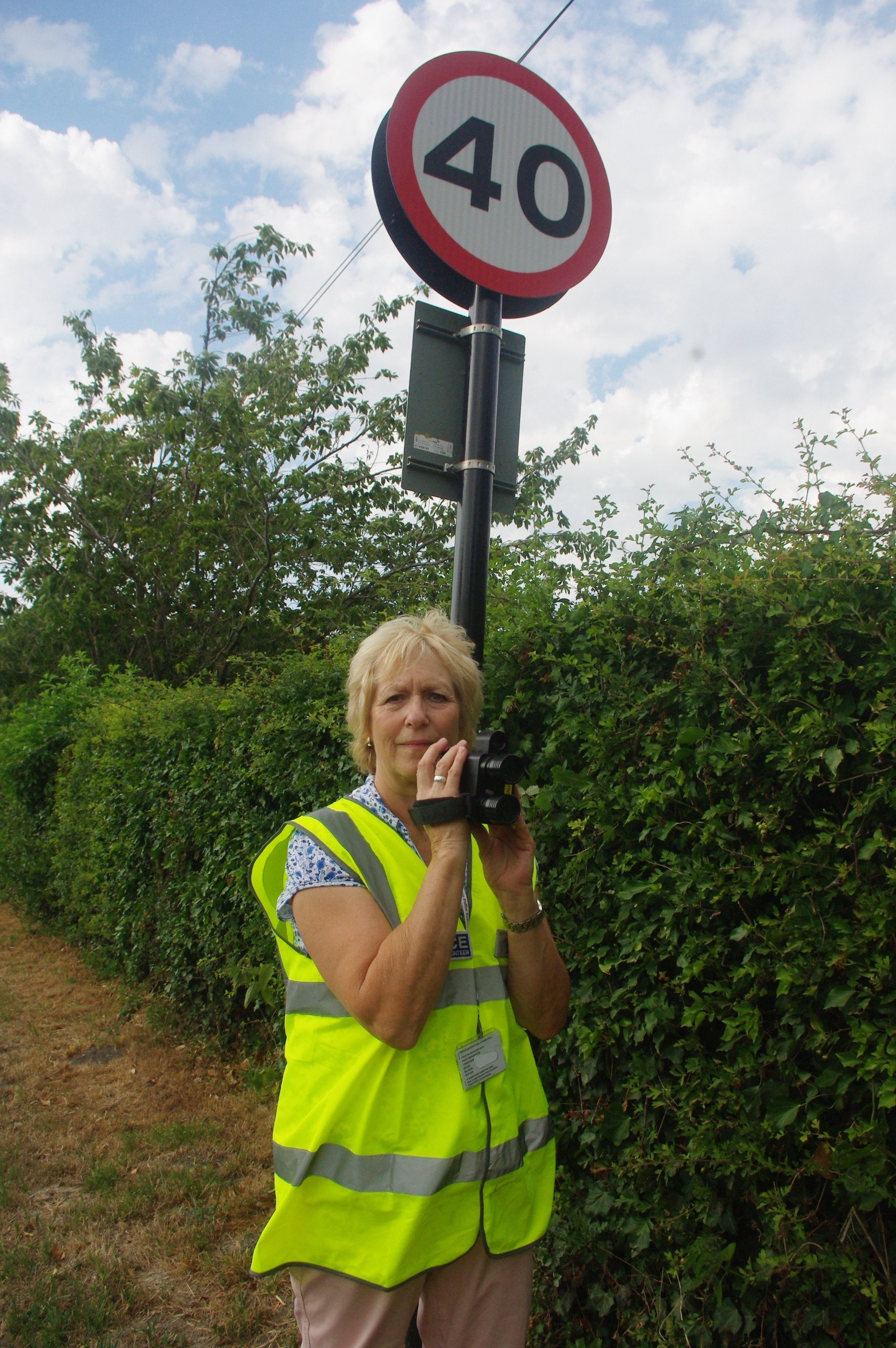 Fran Creasey – the Speedwatch co-ordinator for Compton Bassett underneath the new signs