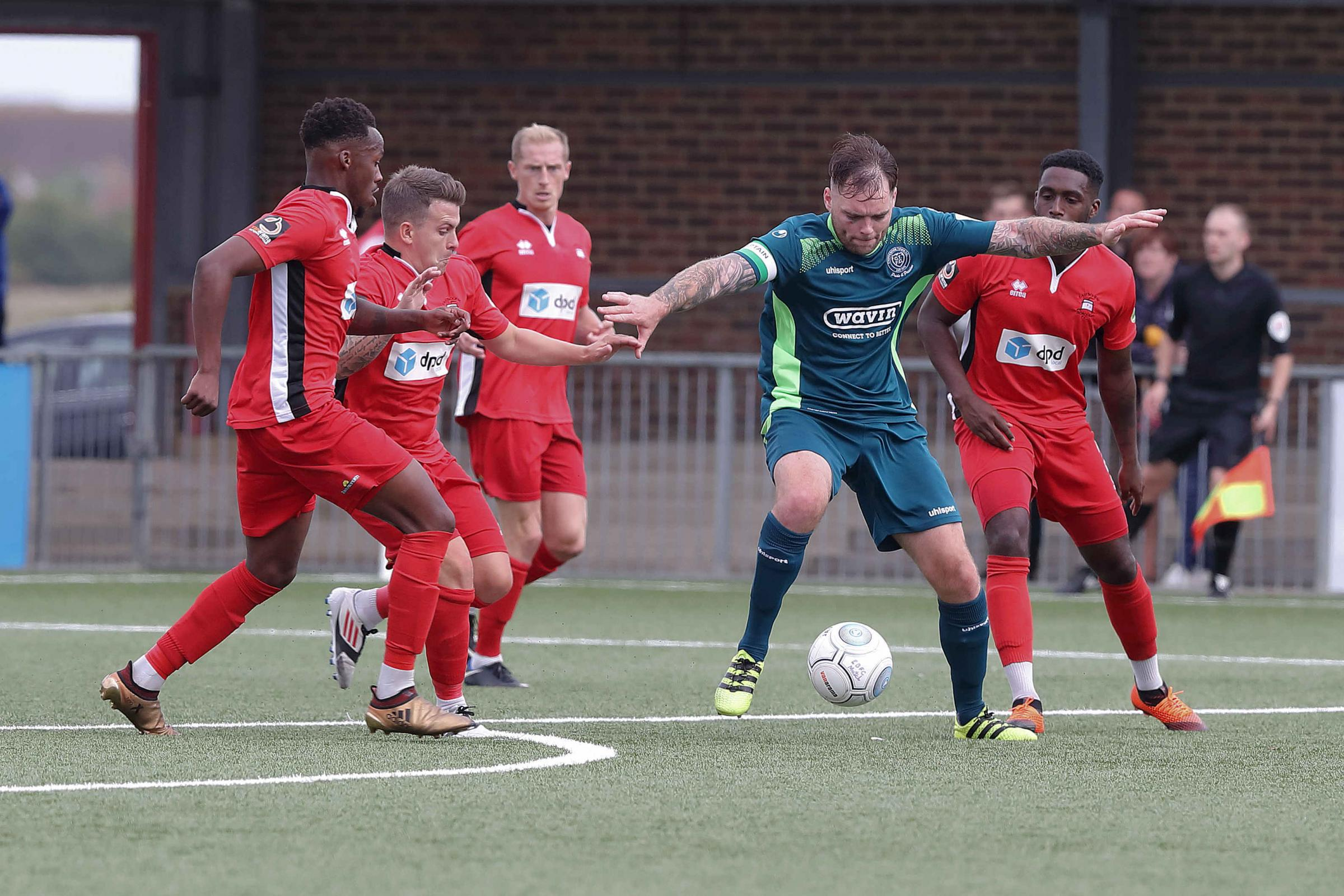 Chippenham Town's Greg Tindle (green) takes on four Eastbourne players during Chippenham Town's 2-1 defeat to Eastbourne Borough. Picture: RICHARD CHAPPELL