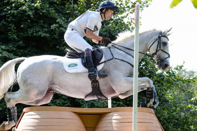 Harry Meade, riding Away Cruising during the cross country phase of the Land Rover Burghley Horse Trials
