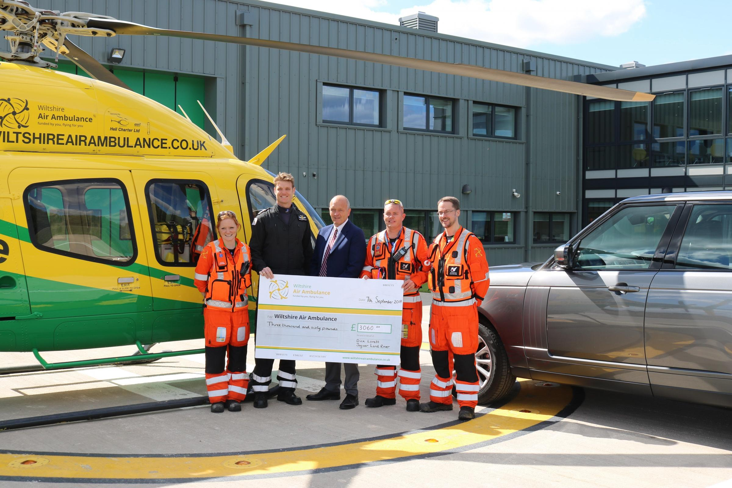 Dick Lovett Jaguar Melksham's Head of Business Richard Davies (centre) presents a cheque for £3,060 to the Wiltshire Air Ambulance crew