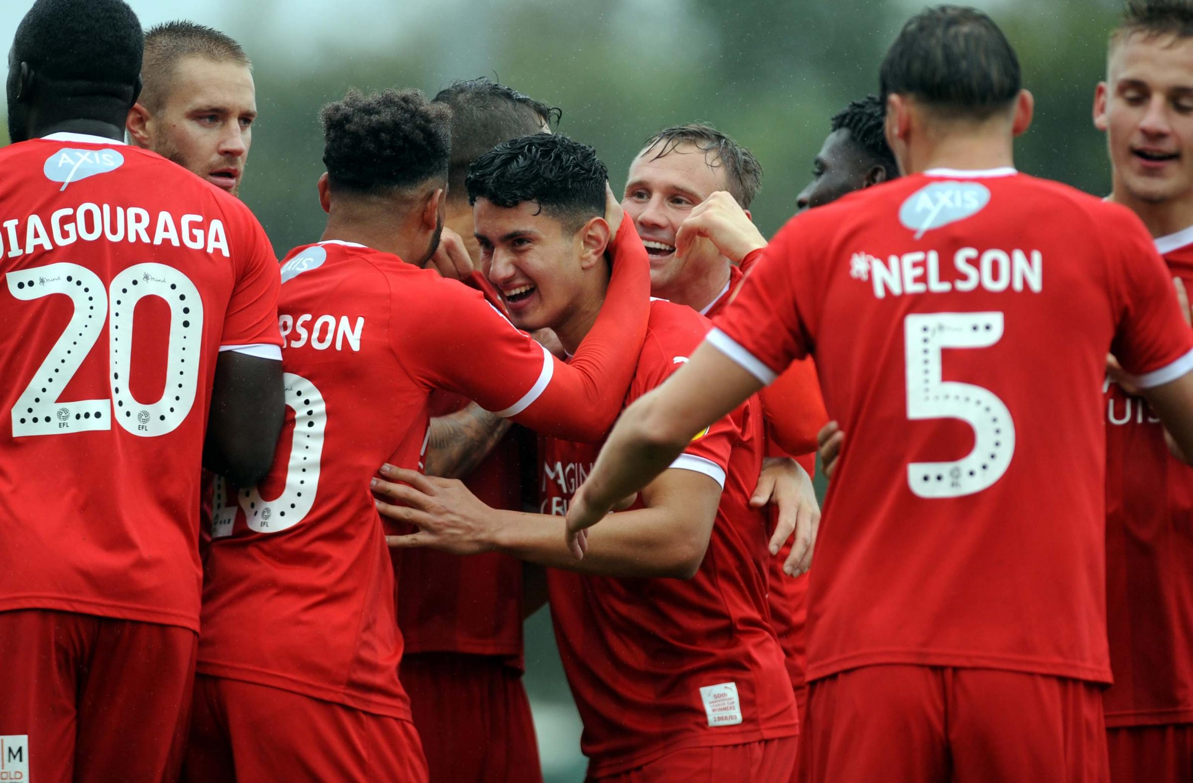 Yeovil v STFC            Pic Dave Evans            22.09.18.Steven Alzate engulfed by team mates after netting Town's first and his first goal for Swindon..