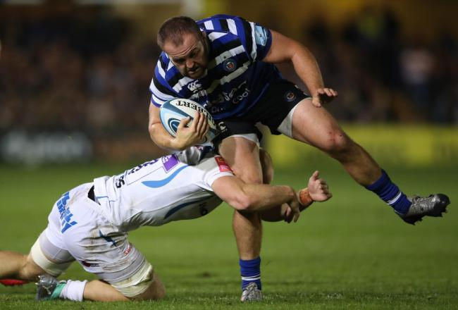 Bath's Tom Dunn is tackled by Exeter Chiefs' Matt Kvesic