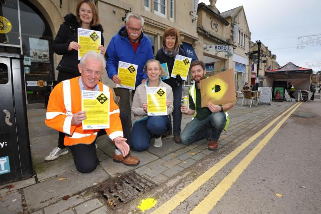 Painting yellow fish emblem on drains in Chippenham as part of the anti water pollution project - Jennifer Staton event coordinator, Keith Dispain, and Gilliam Smith education advisor with, front row, Larry Spiers, stream clean coordinator, Bryony Tizzard