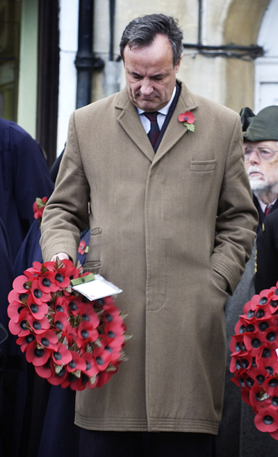 MP James Gray laying a wreath in Chippenham