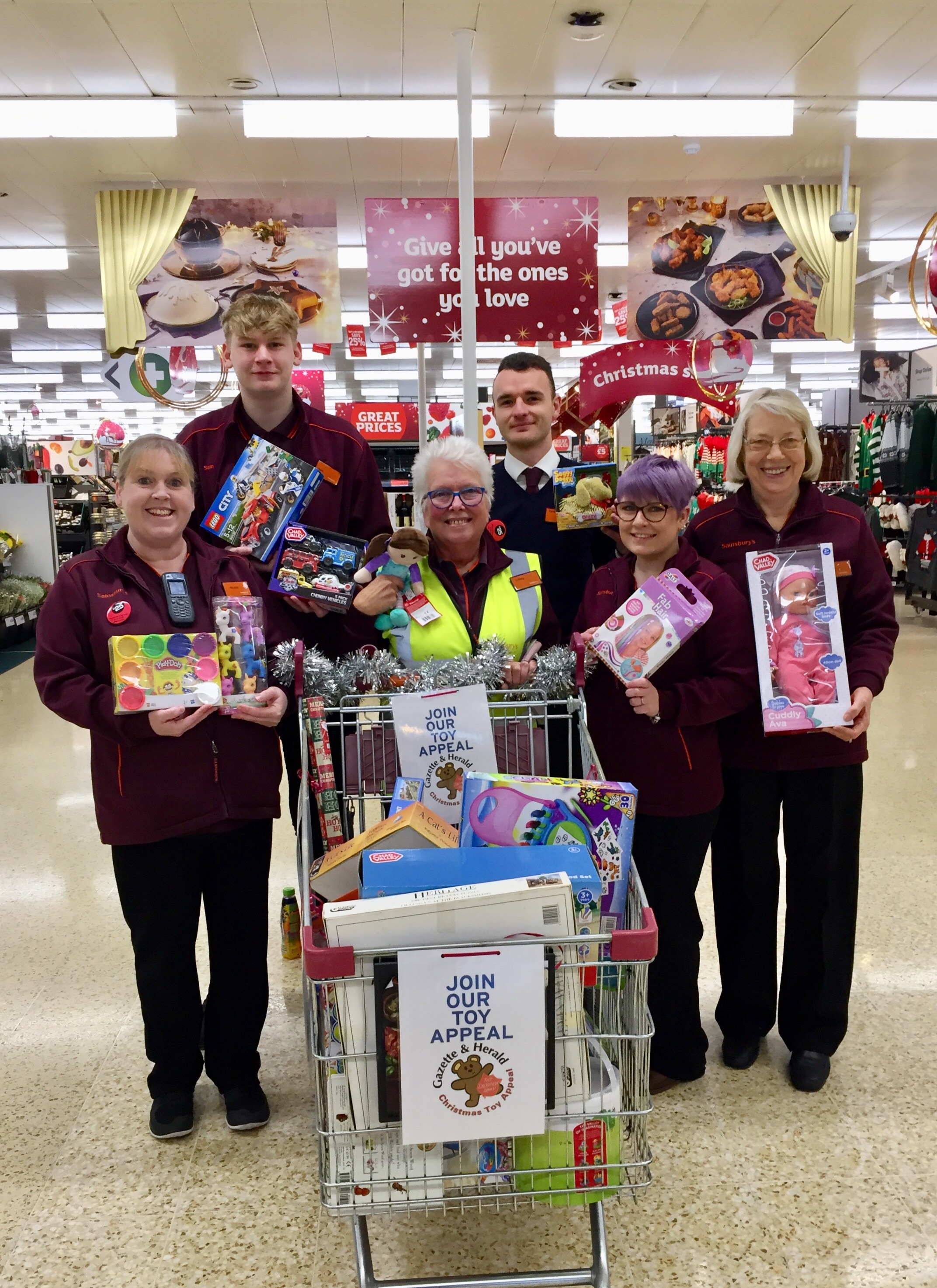 Staff at Sainsbury's with gifts for the Chippenham Christmas Toy Appeal