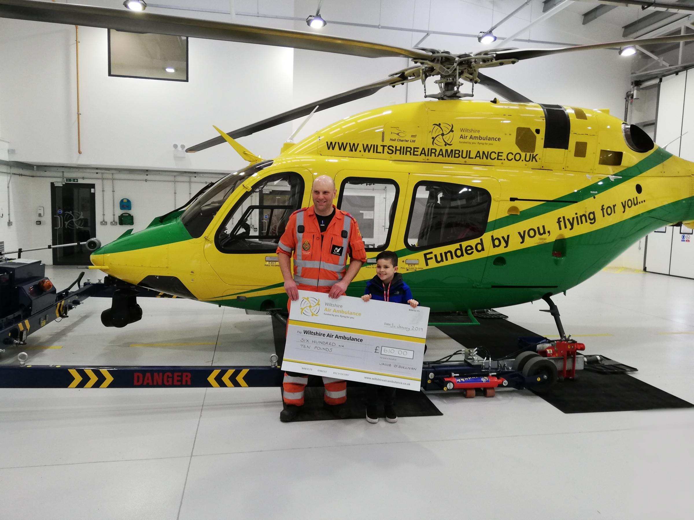 Jacob presenting his check to the Wiltshire Air Ambulance