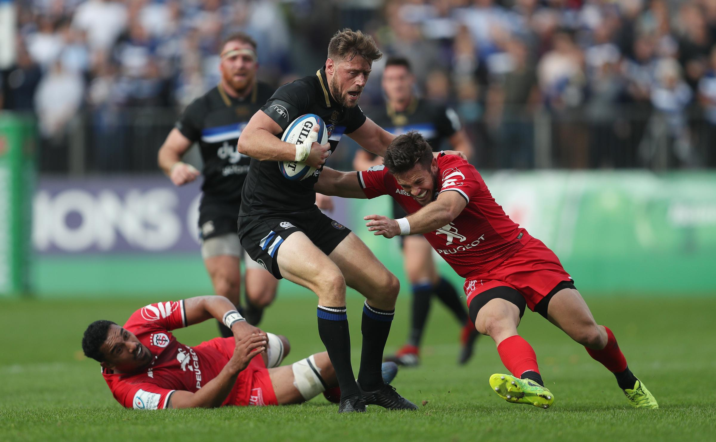 Bath's Rhys Priestland is tackled by Toulouse Zack Holmes  the European Champions Cup match at the Recreation Ground, Bath. PRESS ASSOCIATION Photo. Picture date: Saturday October 13, 2018. See PA story RUGBYU Bath. Photo credit should read: David Dav