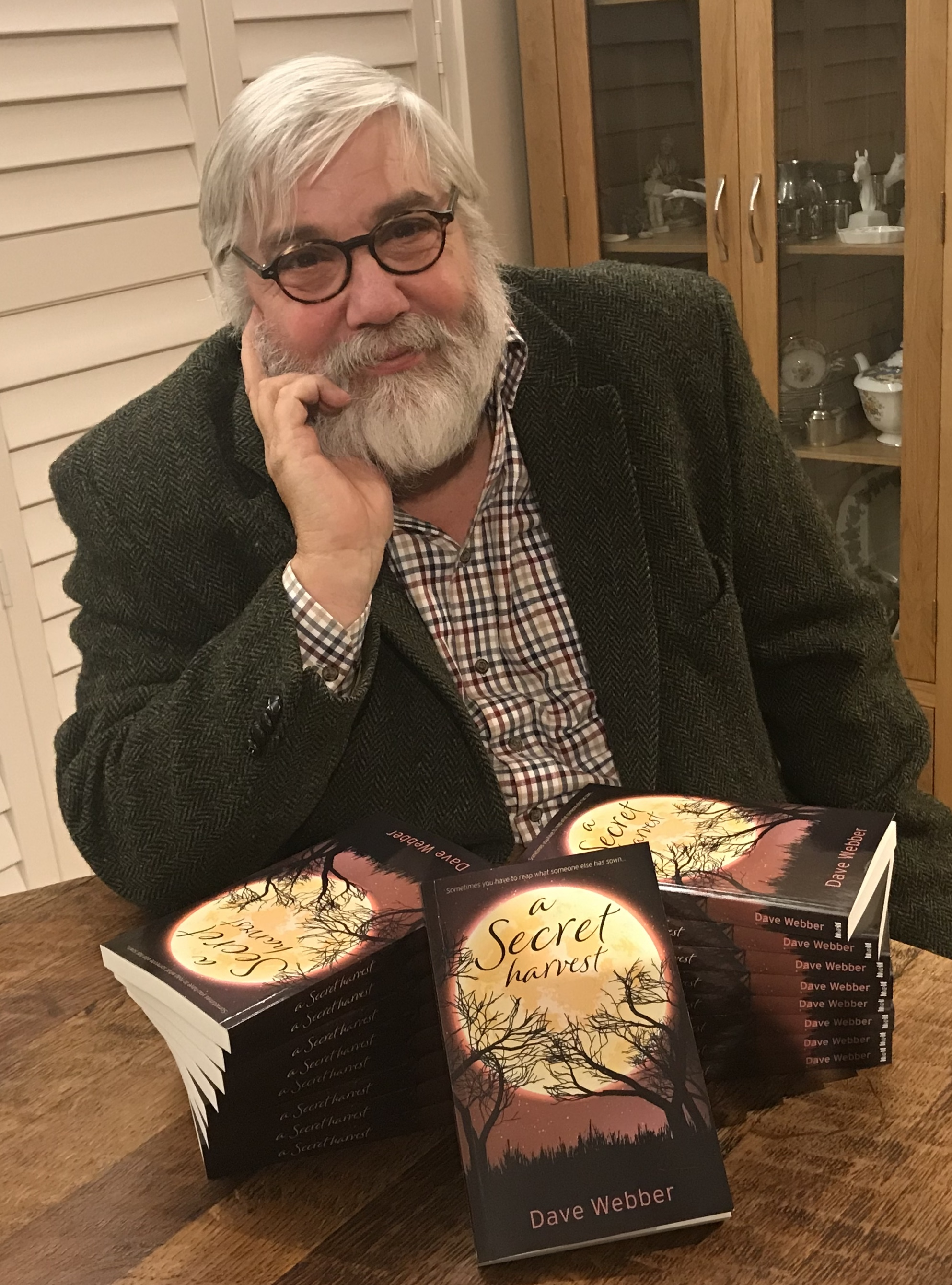 New author Dave Webber with his book A Secret Harvest