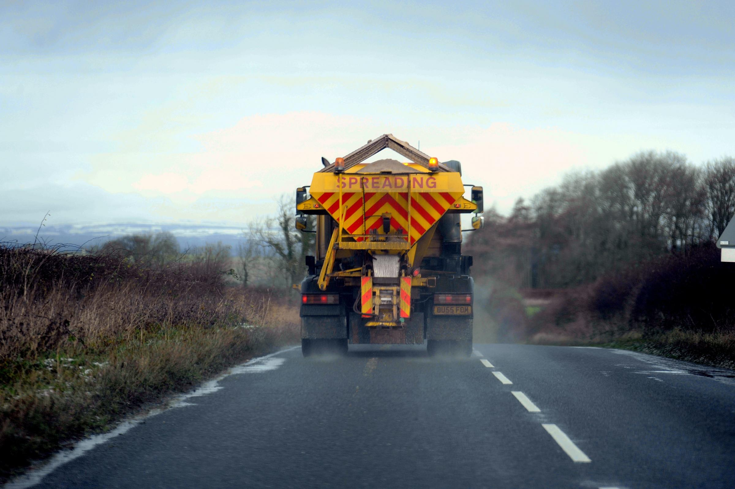 A gritter spreads salt, grit onto the road to prevent ice, black ice. a familiar sight during the winter months when snow and ice disprute the road network: 6 December 2011..                      Pic:STUART WALKER 50027506F000