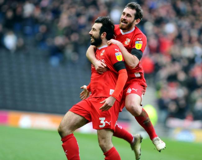 MK Dons v STFC           Pic Dave Evans         9.2.19.Jak McCourt joins goalscorer Michael Doughty in celebrating his first goal.