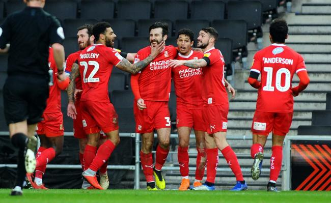 MK Dons v STFC           Pic Dave Evans         9.2.19.Michael Doughty enjoys his colleagues' attention following his successful penalty..