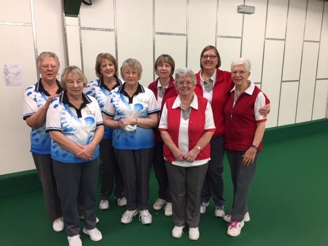 Clarrie Dunbar (blue) and North Wilts (red) players line up ahead of their Mason Trophy match. Pictured are (from left) Jeanette Wheeler, Ruth Jupp, Sue Bird, Pam Trippitt, Sue Cooke, Margaret Cook, Bev Lilley, Jean Collier.