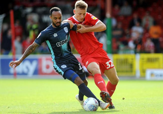 Luke Woolfenden has played 28 games for Swindon Town this season during his loan switch from Championship side Ipswich Town
