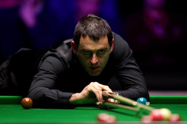 Ronnie O'Sullivan reached the last four in Llandudno after a scrappy contest with Stuart Bingham.