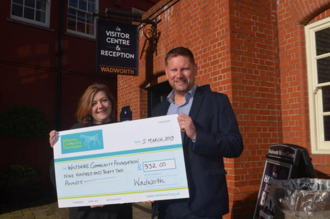 Chris Welham hands cheque to Community Foundation