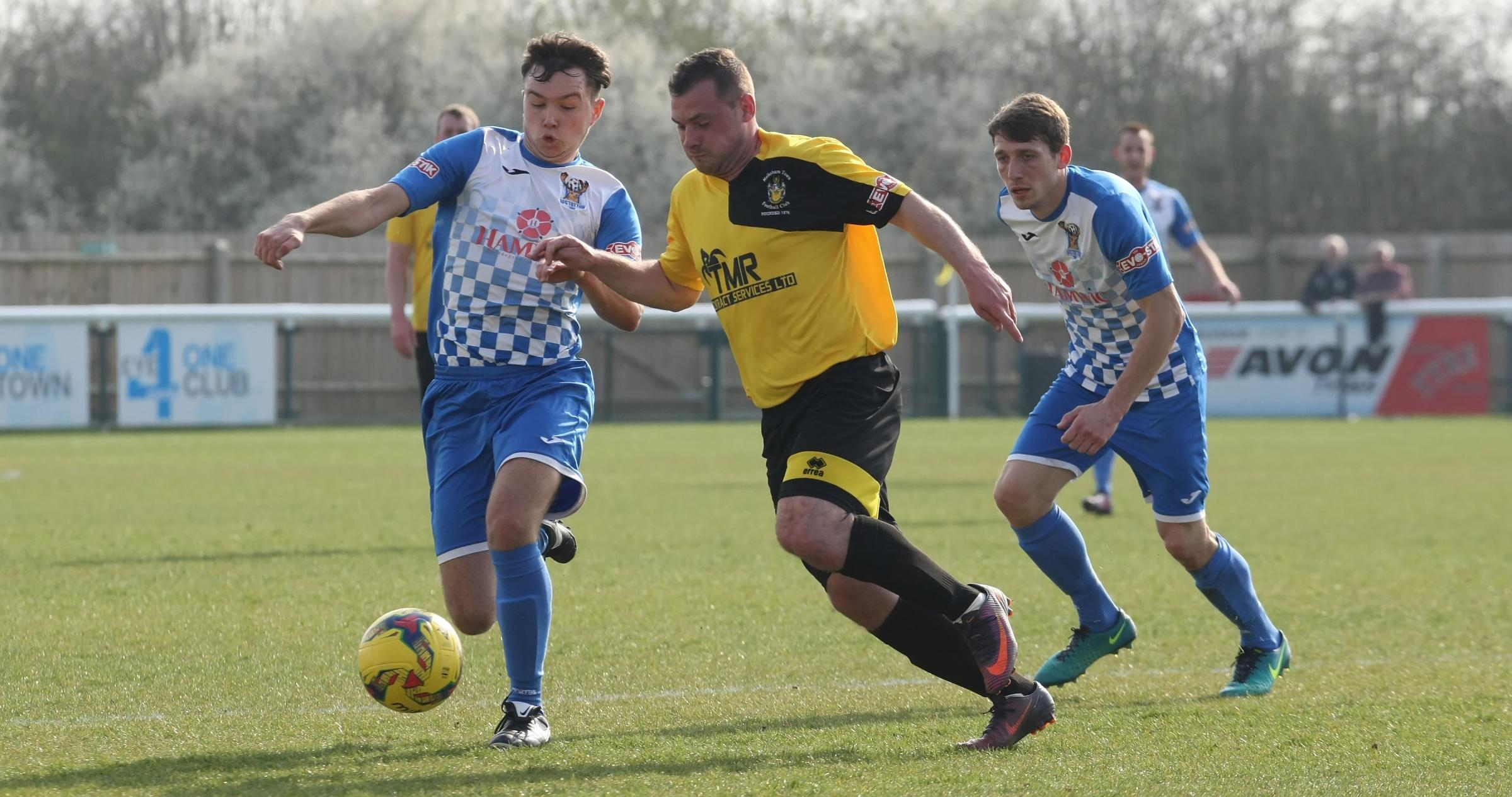 Caretaker manager Luke Ballinger scored for Melksham Town (yellow) in their defeat at Street	   PICTURE: ROBIN FOSTER