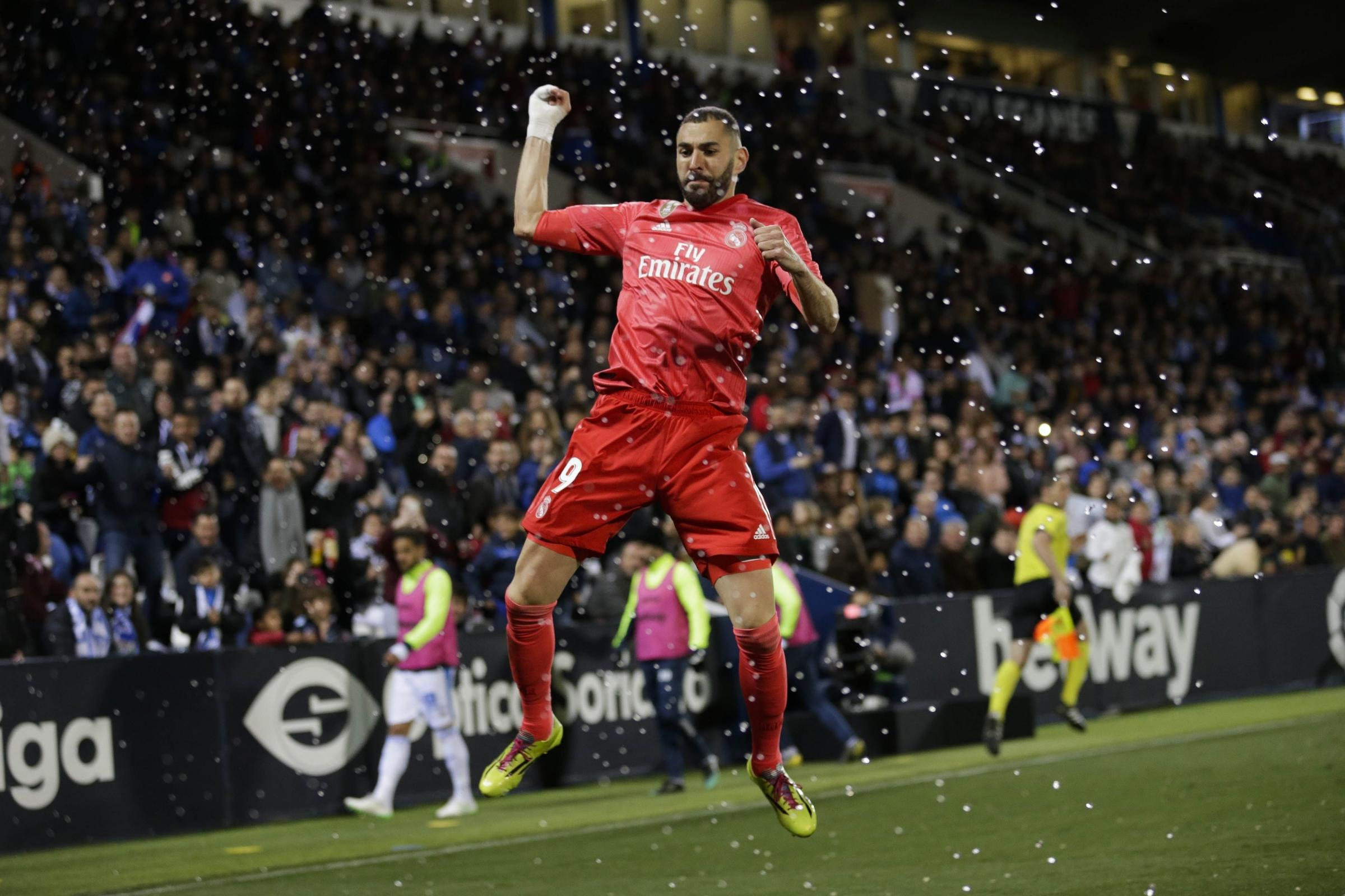 Karim Benzema celebrates his equaliser for Real Madrid early in the second half