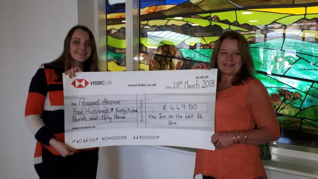 The pub presented a cheque to the hospice