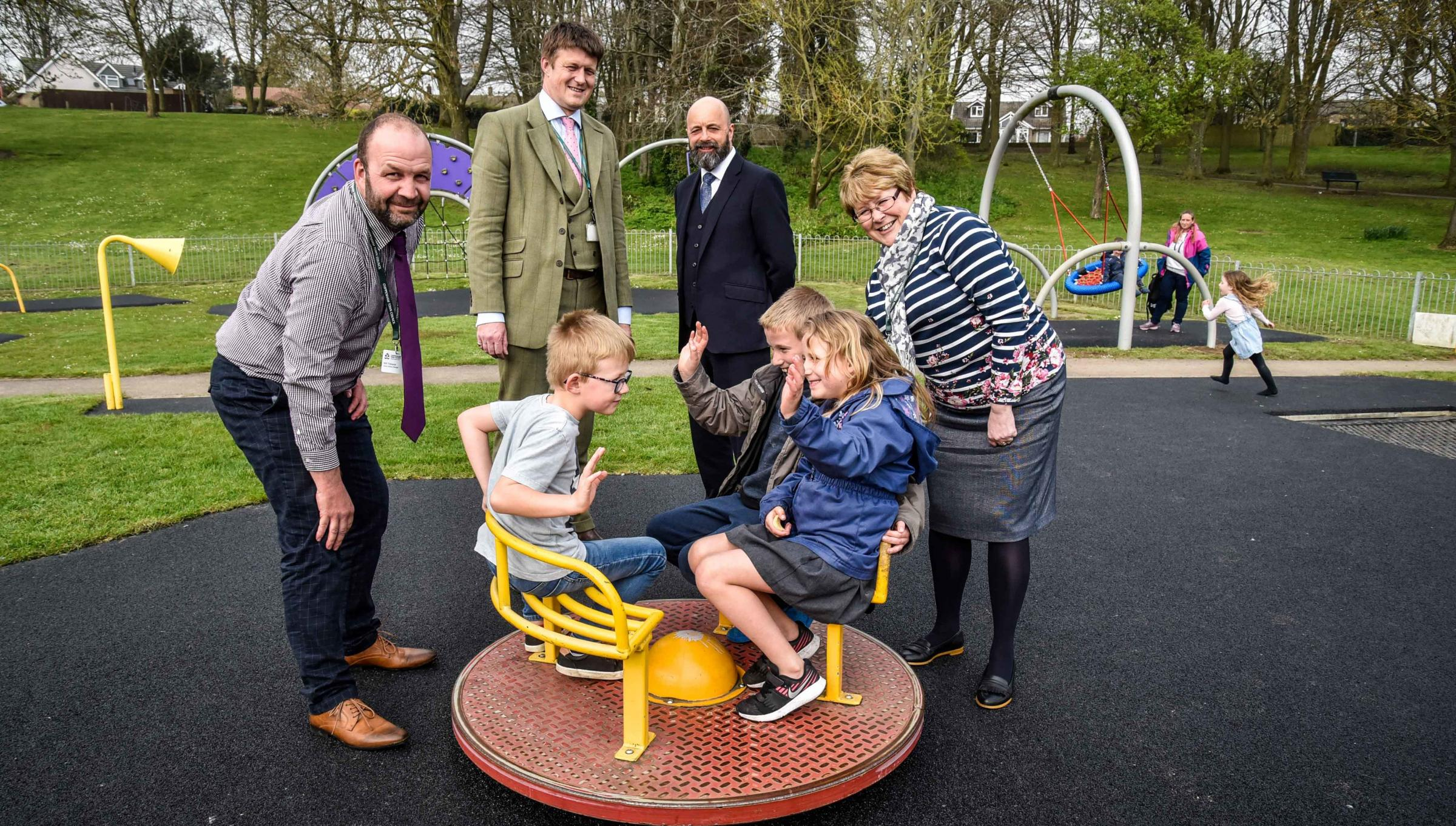 Will Tidmarsh (left),  head of Environmental  services for Chippenham Town Council , county councillor Richard Clewer, CTC chief executive Mark Smith town councillor Teresa Hulton,with youngsters  Theo, Jacob and Courtney  enjoying the reopened  Monkton P