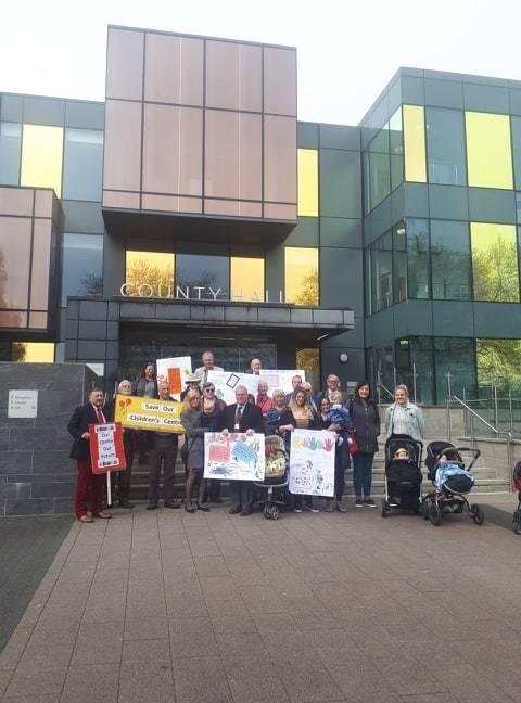 Mums gather outside of County Hall to protest Children's Centre closures