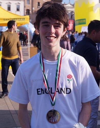 Max Davis with his team medal from the European Junior 10k Road Championships