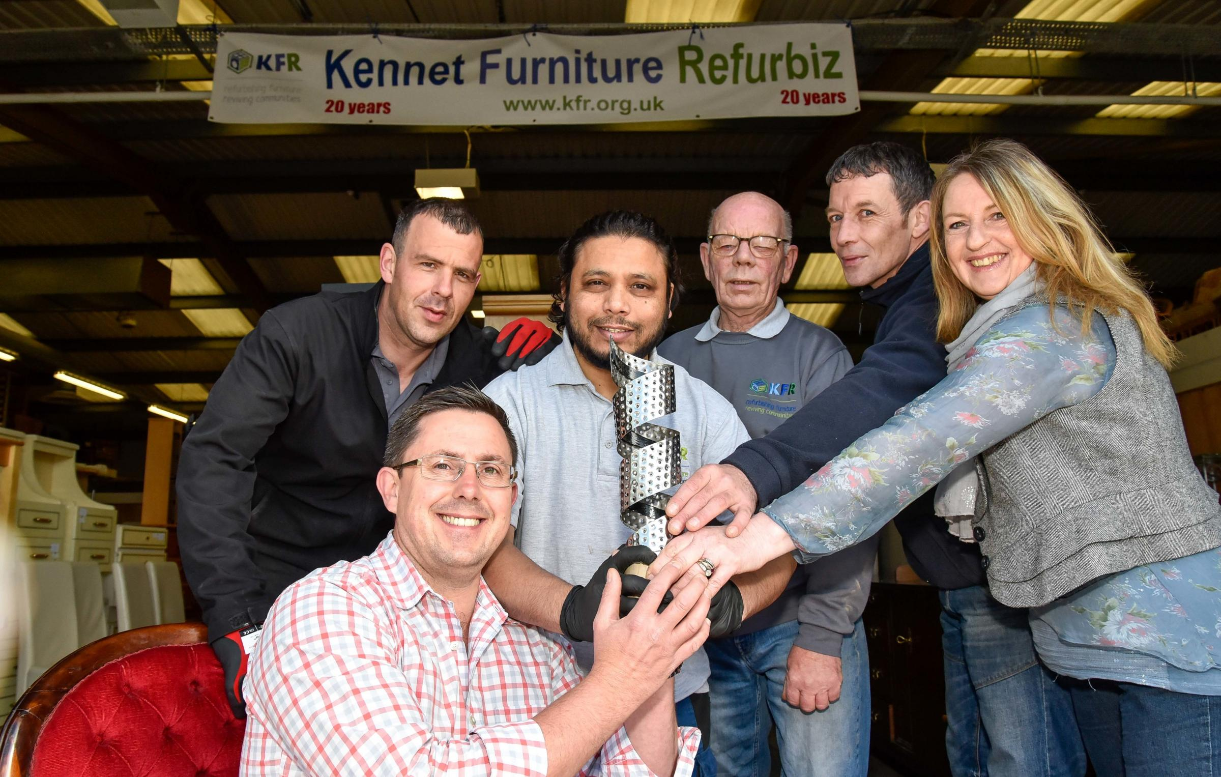 Kennet Furniture Refurbiz operations manager Daniel Thompson with staff  Shaun Salat, Samad Abdul, Keith Brown, Darren Smith and Frances Matthews at their depot in Devizes  with the  Reuse Organisation of the Year award  2019.   Photo by www.gphillipsphot