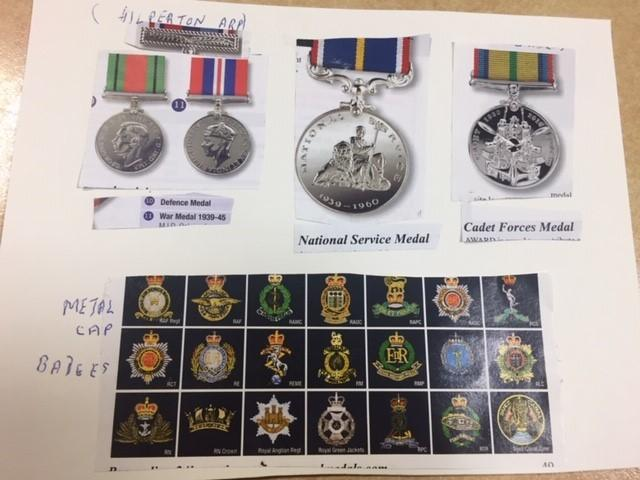 A photograph of the stolen medals and metal cap badges