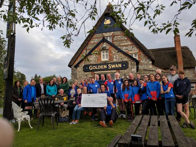 Pewsey Running Club members present charity cash