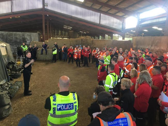 The volunteers are briefed by the police before the search