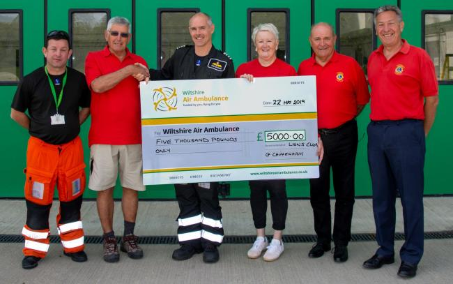 Chippenham Lions present paramedic Fred Thompson and pilot Bob Bacus with the cheque.